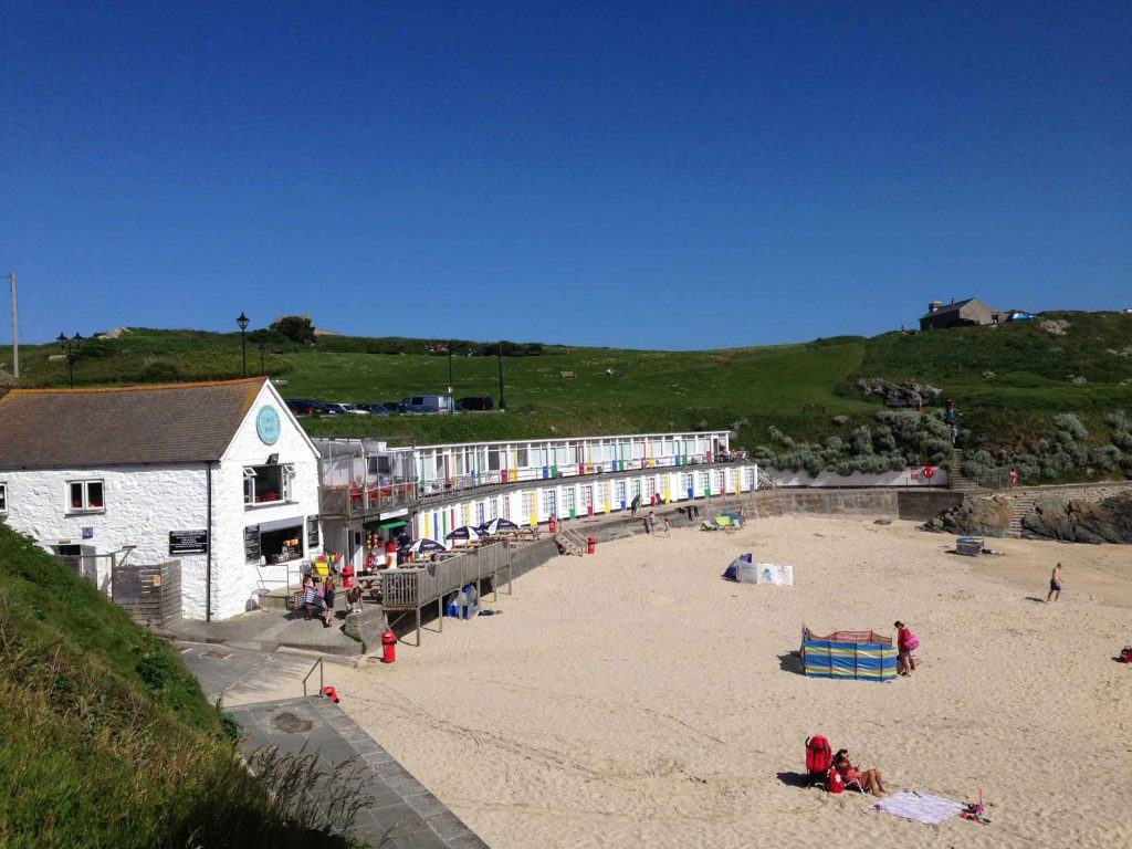 Beach huts on Porthgwidden Beach in St Ives, Cornwall