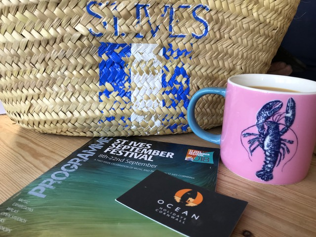 St Ives September Festival programme, cup and bag.