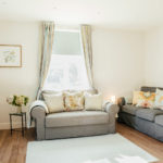Living area of 1 The Elms with two comfortable sofas