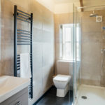 Lower Trowan Cottage bathroom with shower, basin and toilet