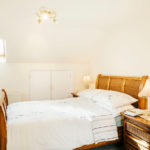 Master bedroom with double bed in Mylor