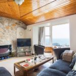 Living area and TV in Mount View with sea views